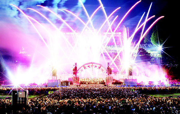 The Vienna Philharmonic Orchestra performs on stage during the open air concert 'Sommernachtskonzert' (Summer Night Concert) at the Schoenbrunn Palace in Vienna on May 26. (AFP)