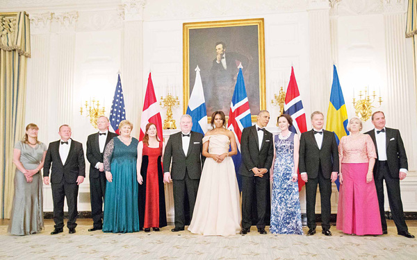 US President Barack Obama and First Lady Michelle Obama stand with Nordic leaders and their spouses, during a photograph in the State Dining Room of the White House in Washington on May 13, during a State Dinner. From left are: Solrun Lokke Rasmussen wife of Danish Prime Minister Lars Lokke Rasmussen, Sindre Finnes, husband of Norwegian Prime Minister Erna Solberg, Ingibjorg Elsa Ingjaldsdottir wife of Iceland Prime Minister Sigurdur Ingi Johannsson, Jenni Haukio wife of Finnish President Sauli Niinisto, and Ulla Lofven wife of Swedish Prime Minister Stefan Lofven. (AP)