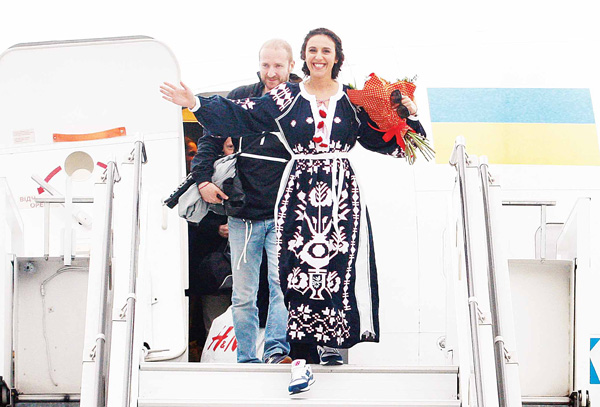 Ukrainian singer Jamala gets off the plane as she arrives in Kiev Boryspil airport on May 15, after winning the final of the 2016 Eurovision Song Contest. (AFP)