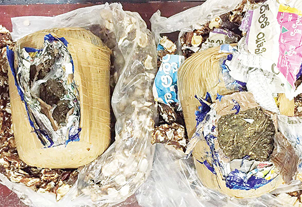 The 2 wraps of hashish seized from the Asian.