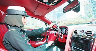 In this May 19, 2016 photo, police offi cer Bodoor Jassim al Saffar takes the wheel of a Bentley Continental GT police car during a demonstration in Dubai, United Arab Emirates. (AP)