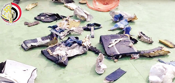 This still image taken from video posted on Saturday, on the offi cial Facebook page of the Egyptian Armed Forces spokesman shows some personal belongings and other wreckage from EgyptAir Flight 804. (AP)