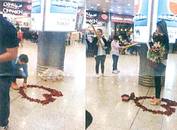 The Arab expat laying flowers in the shape of a heart at the arrivals section