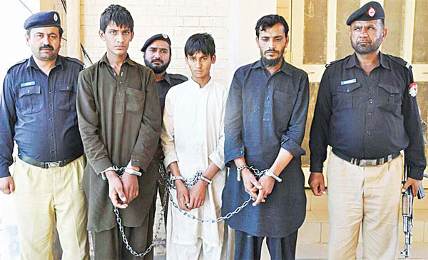 In this handout photograph released by Punjab police and taken on May 2, Pakistani policemen escort Tariq Mehmood (second right), his younger brother Khalid Mehmood (second left), and an employee (center), at a court in the Karor Lal Esan area of Pakistan's Punjab province. A Pakistani sweet shop owner has confessed to fatally poisoning at least 30 people by lacing his goods with pesticide in an attempt to take revenge on his older brother, police told AFP on May 6. (AFP)