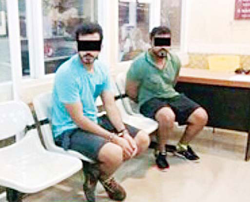 Photo shows 2 Bedouns involved in the stabbing of a Kuwaiti citizen in Thailand.