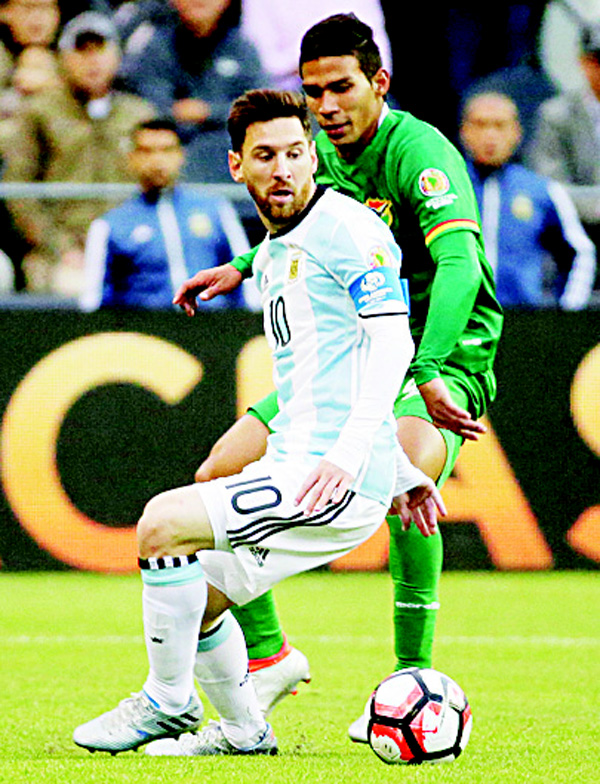 Argentina's Lionel Messi (front), and Bolivia's Diego Bejarano fight for the ball during a Copa America Centenario Group D soccer match on June 14, at CenturyLink Field in Seattle. (AP)