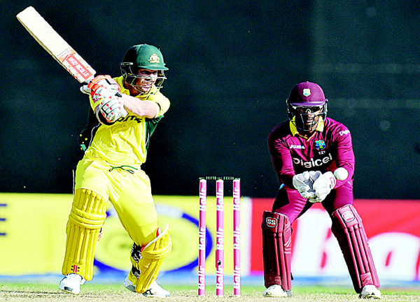 Australia's Usman Khawaja plays a shot during a One-Day International (ODI) cricket match between the West Indies and Australia in the Tri-Nation Series in Georgetown, Guyana on June 5. (AFP)