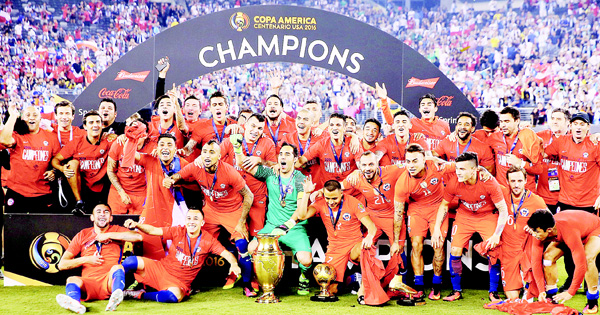 Chile celebrates the win over Argentina during the Copa America Centenario Championship match at MetLife Stadium on June 26, in East Rutherford, New Jersey. (AFP)