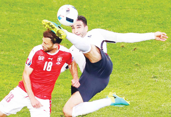 France's Adil Rami kicks the head of Switzerland's Admir Mehmedi during the EURO 2016 Group A soccer match between Switzerland and France at the Pierre Mauroy Stadium in Villeneuve d'Ascq, near Lille, France on June 19. (AP)