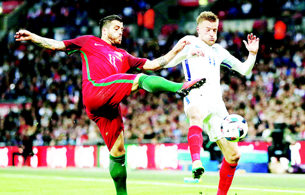 Portugal's Vieirinha (left), vies with England's striker Jamie Vardy during the friendly football match between England and Portugal at Wembley Stadium in London on June 2. (AFP)