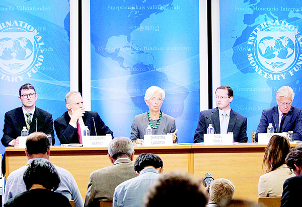 This IMF photo shows International Monetary Fund Managing Director Christine Lagarde (center), Mission Chief Nigel Chalk (2nd right), Division Chief Stephan Danniger (left), Director Alejandro Werner (2nd left), and Communications Director Gerry Rice (right), as they hold a joint press conference on the conclusion of the 2016 US Article IV consultation June 22, at the IMF Headquarters In Washington, DC. (AFP)