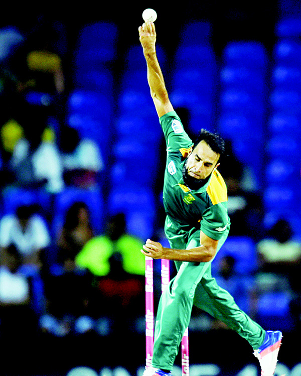 South African cricketer Imran Tahir delivers a ball during the 6th One Day International match of the Tri-nation Series between West Indies and South Africa at the  Warner Park Stadium in Basseterre, Saint Kitts, on June 15. (AFP)