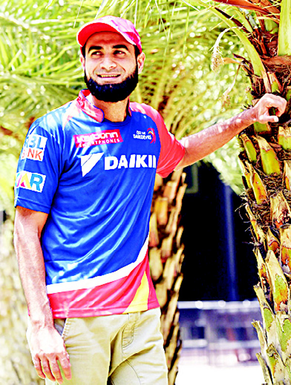 In this photograph taken on April 29, 2016, South African cricketer Imran Tahir, who plays for Delhi Daredevils in the Indian Premier League (IPL), poses during an interview with AFP in New Delhi. (AFP)