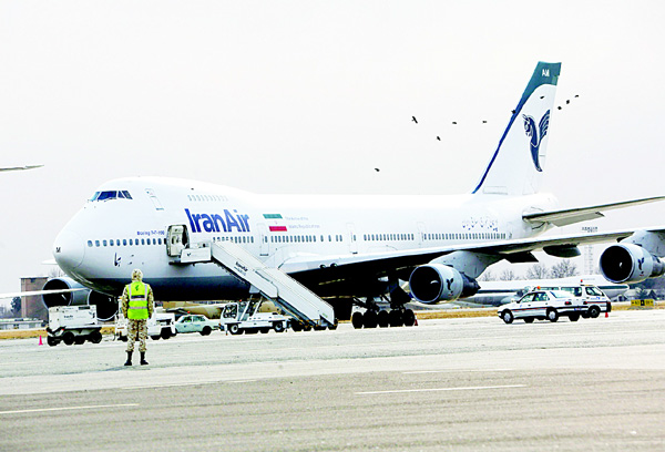 This file photo shows an Iran Air Boeing 747 passenger plane sitting on the tarmac of the domestic Mehrabad Airport in the Iranian capital Tehran. Iran and US aerospace giant Boeing have reached an agreement for the purchase of 100 aircraft to renew the country's ageing fleet, the head of Tehran's civil aviation authority announced on June 19. The Islamic republic has ordered about 200 planes from three Western manufacturers since mid-January when economic sanctions were lifted following a deal on Tehran's nuclear programme. (AFP)