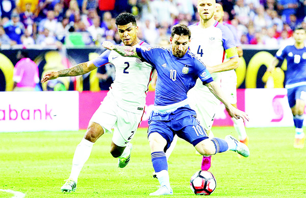 Lionel Messi #10 of Argentina kicks the ball against DeAndre Yedlin #2 of United States in the first half during a 2016 Copa America Centenario Semifinal match at NRG Stadium on June 21, in Houston, Texas. (AFP)