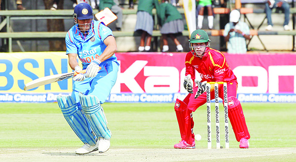Indian batsman Mahendra Dhoni in action at the wicket during their T20 cricket match against Zimbabwe in Harare, Wednesday, June 22, 2016. (AP Photo/Wonder Nzombe)