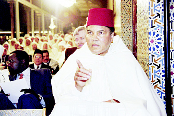 This file photo taken on Jan 15, 1998 shows former world heavyweight champion Muhammad Ali participating in a religious ceremony for the Holy Month of Ramadan at the Royal Palace in Rabat. (AFP)