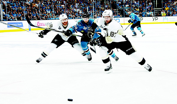 Melker Karlsson #68 of the San Jose Sharks races towards the puck against Sidney Crosby |#87 and Ian Cole #28 of the Pittsburgh Penguins in Game Four of the 2016 NHL Stanley Cup Final at the SAP Center at San Jose on June 6 in San Jose, California. (AFP)