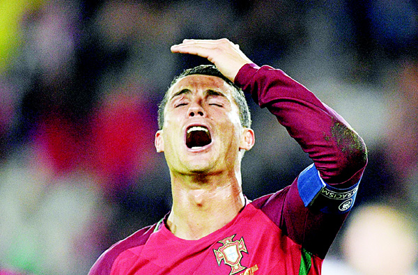 Portugal's forward Cristiano Ronaldo reacts after he missed to score a penalty during the EURO 2016 Group F football match between Portugal and Austria at the Parc des Princes in Paris on June 18. (AFP)