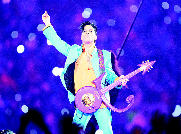 In this Feb 4, 2007 file photo, Prince performs during the halftime show at the Super Bowl XLI football game at Dolphin Stadium in Miami. For the first full sales week following Prince's death on April 21, five of his albums were in Billboard's top 10, at Nos 2, 3, 4, 6 and 7. Only Beyonce's 'Lemonade' kept him from the top, Billboard says no artist has had that many albums in the Top 10. (AP)