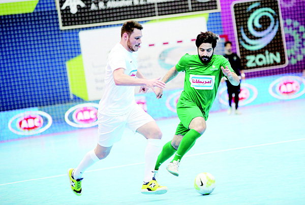 Players fight for the ball in one of the matches during the Ramadan Indoor tournament.