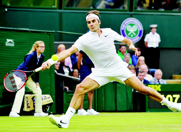 Switzerland's Roger Federer returns against Britain's Marcus Willis in their men's singles second round match on the third day of the 2016 Wimbledon Championships at The All England Lawn Tennis Club in Wimbledon, southwest London, on June 29. (AFP)