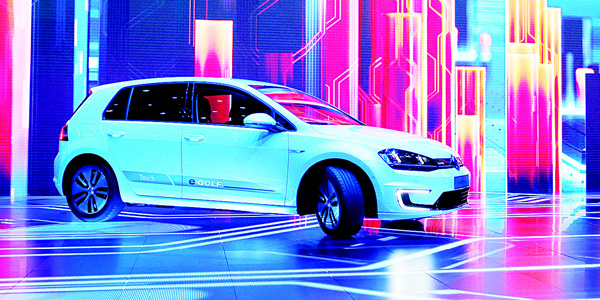 In this file photo Volkswagen unveils the e-Golf Touch electric car during a keynote address at CES International in Las Vegas, United States. CEO Matthias Mueller said on June 16, the company plans to introduce more than 30 electric-powered vehicles by 2025, and to sell 2 to 3 million of them a year. (AP)