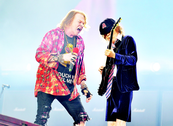 Singer Axl Rose (left), and Angus Young of the AC/DC perform at the Olympic Stadium in London on June 4. (AP)
