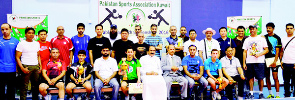 Winners, participants, officials and guests pose for a group photo after the award ceremony of Table Tennis Championship Open organized by the Pakistan Sports Association Kuwait.