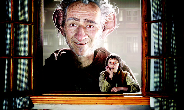This image released by Disney shows Ruby Barnhill (right), and Big Friendly Giant from Giant Country, voiced by Mark Rylance, in a scene form 'The BFG'. (AP)