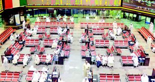 Traders watch share movements on the floor of the Kuwait Stock Exchange. The bourse dropped 10.21 points on Thursday.