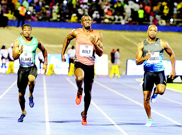 Usain Bolt (center), wins the 100-meter final ahead of Yohan Blake (left), and Asafa Powell in the Racers Grand Prix track and  field event at the National Stadium in Kingston, Jamaica, on June 11. (AP)