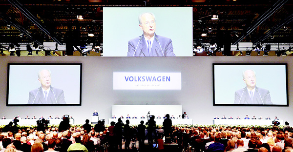 Volkswagen (VW) chairman of the Board Hans Dieter Poetsch addresses the audience at the German carmaker Volkswagen shareholders' annual general meeting on June 22 in Hanover. The Volkswagen shareholders are expected to vent their anger over the emissions cheating scandal that plunged the auto giant into a  major crisis. (AFP)