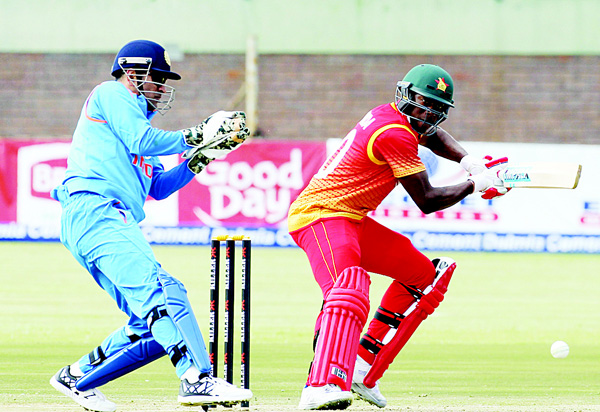 Zimbabwean batsman Vusimusi Sibanda (right), plays a shot as Indian wicket-keeper and captain MS Dhoni fields, during the One Day International cricket match between Zimbabwe and India, at the Harare Sports Club in Harare on June 13. (AP)