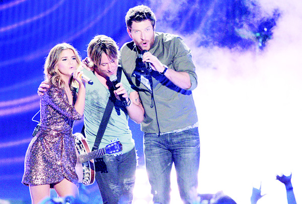 Maren Morris (from left), Keith Urban and Brett Eldredge perform 'Wasted Time' at the CMT Music Awards at the Bridgestone Arena on June 8 in Nashville, Tenn. (AP)