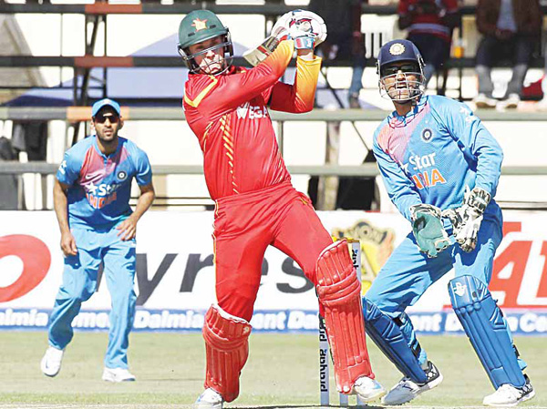 Zimbabwean batsman Malcom Waller plays a shot during the T20 international cricket match against India at Harare Sports Club, in Harare, June 20. The Indian cricket team is in Zimbabwe for One Day International and T20 matches. (AP)