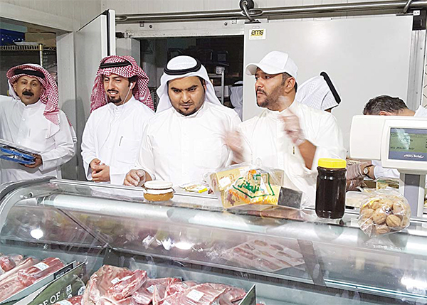 Food inspectors at one of the markets in Fahaheel