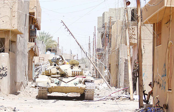 An Iraqi army tank is seen in Falluja, 50 kms (30 miles) from the capital Baghdad, after Iraqi forces retook the embattled city from the Islamic State group on June 26. (AFP)