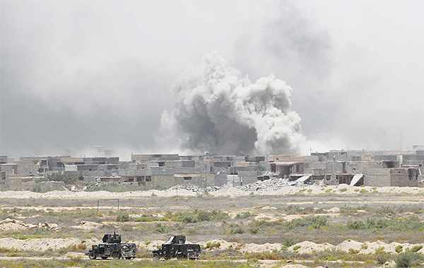Smoke billows from Falluja's southern Shuhada neighbourhood following shelling during an operation by Iraqi government forces, backed by air support from the US-led coalition, to regain control of the area from the Islamic State (IS) group on June 10. Iraq's elite counterterrorism service moved to within three kilometres of central Falluja and consolidated positions in the south of the city, the operation's commander Lieutenant General Abdelwahab al-Saadi said. (AFP)