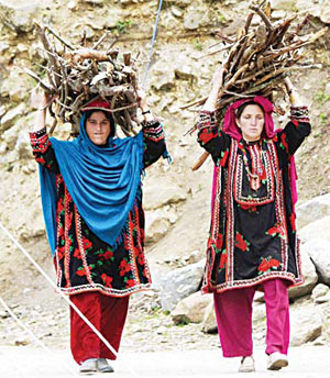 In this photograph taken on May 27, 2016, pregnant Pakistani Kashmiri women carry firewood on their heads as they walk in a village near Sharda in the mountainous region of Neelum Valley. In 2014, a report by the charity Save the Children stated Pakistan had the highest rate of first day deaths and stillbirths in the world, at 40.7 per 1,000 births. (AFP