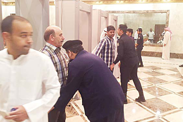 Worshippers are frisked before entering the mosque