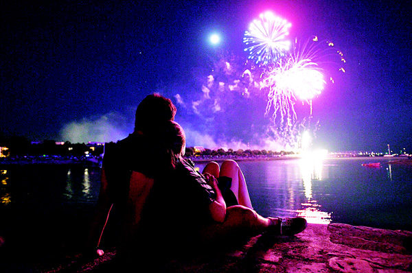 A couple watches the fireworks during the Francofolies Music Festival in La Rochelle on July 14. (AFP)