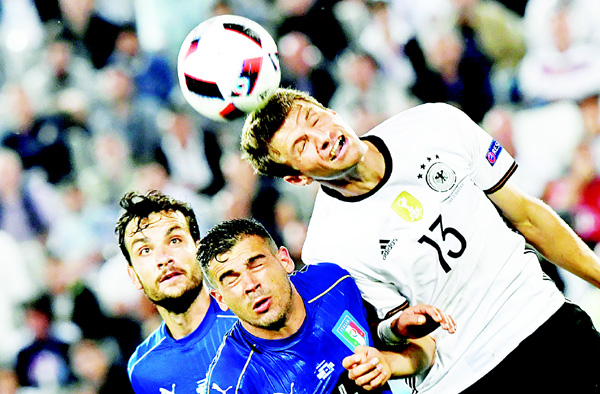 Italy's midfielder Stefano Sturaro and Germany's midfielder Thomas Mueller jump for the ball during the EURO 2016 quarter-final football match between Germany and Italy at the Matmut Atlantique Stadium in Bordeaux on July 2. (AFP)