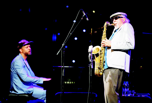 Legendary American jazz musician Charles Lloyd, who headlined the first festival in Montreux in 1967 performs on stage at the opening of the 50th edition of the Montreux Jazz Festival on June 30, in Montreux. (AFP)