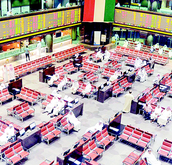 Traders watch share movements on the floor of KSE. The bourse gained 8.35 pts on Wednesday.