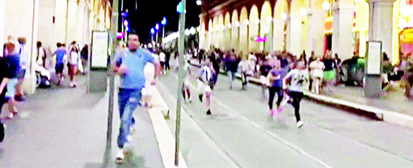An image grab obtained from the Instagram account of GA Morrow, shows people running away from the scene of an attack in the French Riviera city of Nice during Bastille Day on July 14. A gunman smashed a truck into a crowd of revellers celebrating Bastille Day in the French Riviera city of Nice, killing at least 84 people in what President Francois Hollande on Friday called a 'terrorist' attack. Police shot the driver dead after he drove the truck two kilometres (1.3 miles) through a crowd that had been enjoying a fireworks display on France's July 14 national holiday. (AFP)