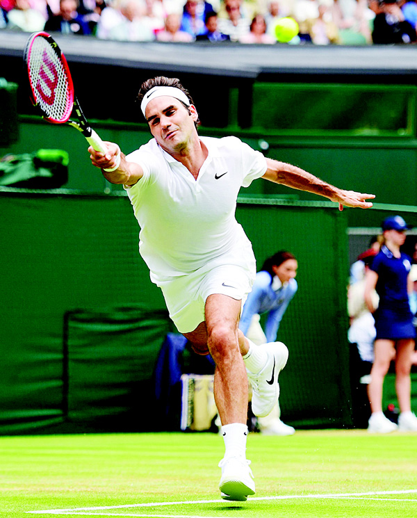 Switzerland's Roger Federer returns to US' Steve Johnson during their men's singles fourth round match on the eighth day of the 2016 Wimbledon Championships at The All England Lawn Tennis Club in Wimbledon, southwest London on July 4. (AFP)
