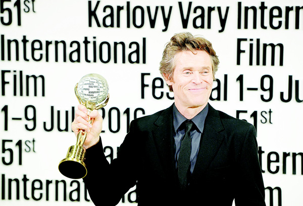 US actor Willem Dafoe poses for photographers after being awarded with the Crystal Globe Award for Outstanding Artistic Contribution to World Cinema at the 51th Karlovy Vary International Film Festival (KVIFF), in Karlovy Vary, Czech Republic on July 1. (AFP)
