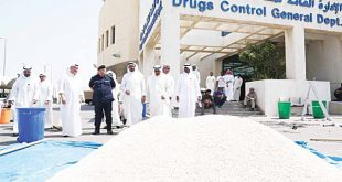 Ministry of Interior and Drugs Control General Department officials with the confiscated 'Captagon' pills.