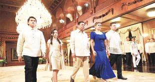 This handout photo taken on June 30, and released by the Presidential Communication Operations Office (PCOO) shows Philippines President Rodrigo Duterte (center), walking with his children Sebastian (left), Veronica (second left), Sara (second right) and Paolo (right) after the oath-taking ceremony at the Malacanang Palace in Manila. (AFP)